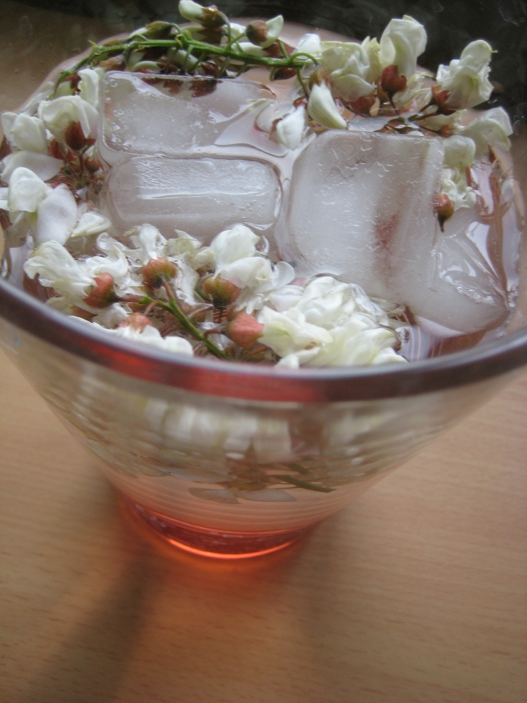 black locust flower infusion with ice and strawberry syrup